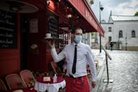 In Paris, locals shrugged off the intermittent rain and headed for the cafe terraces