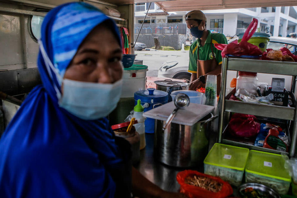 Cendol seller, Rosnah Sofian, 50, (left) and Mohd Aiman Firdaus 18 speak to Malay Mail during an interview at UTC Sentul July 2, 2020. — Picture by Hari Anggara
