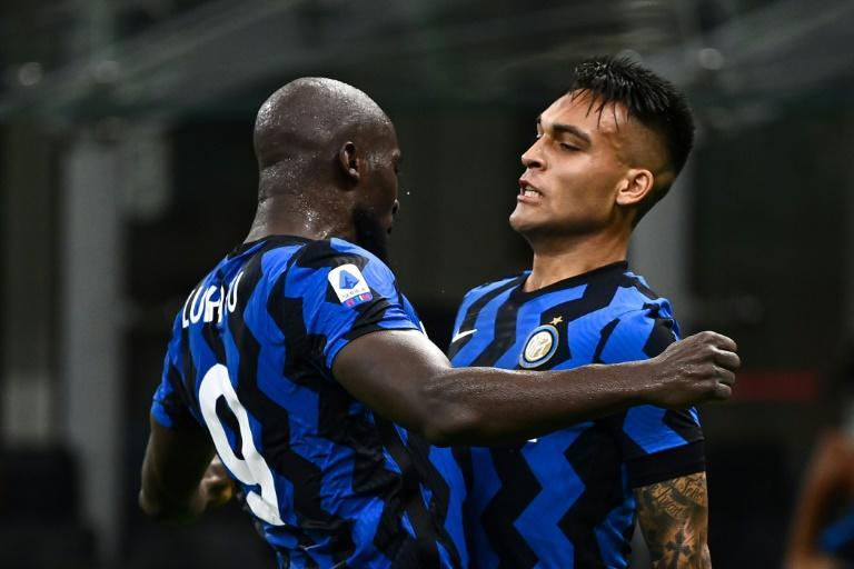 Lautaro Martinez (R) secured victory for Inter Milan as they reclaimed second place in Serie A (AFP Photo/MARCO BERTORELLO)