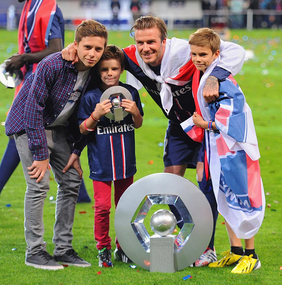 David Beckham had a little help saying goodbye on Saturday when he played his last professional soccer game in Paris on Saturday and was joined by a few of his biggest fans -- sons Brooklyn, Cruz, and Romeo -- on the field afterwards. (5/18/2013)