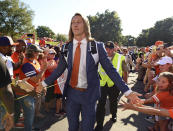 FILE - In this Aug. 29, 2019, file photo, Clemson's Trevor Lawrence greets fans as he arrives for the team's NCAA college football game against Georgia Tech in Clemson, S.C. Trevor Lawrence and Zach Wilson are expected to be the top two picks selected in the NFL Draft on Thursday, April 29, 20212, in Cleveland. (AP Photo/Richard Shiro, File)