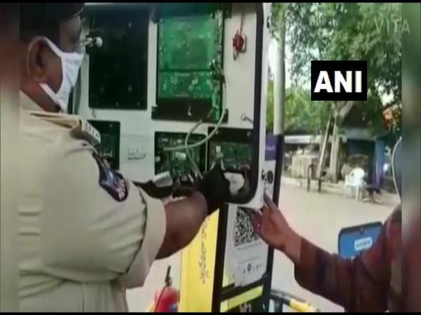 Two chips were found attached to the keypad of a fuel dispenser in a Petrol Pump. (Photo/ANI)