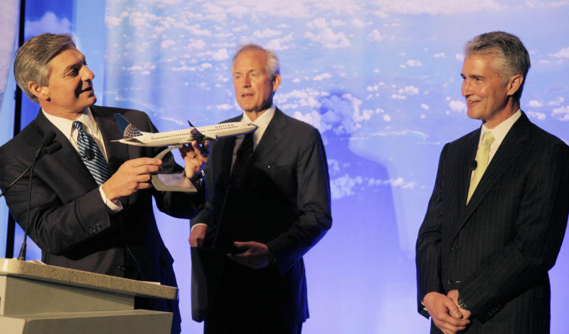 Boeing Commercial Airplanes CEO Ray Conner, presents a model of Boeing's new 737 Max 9 to United Airlines CEO Jeff Smisek, right, during a news conference as Boeing CEO Jim McNerney looks on, Thursday, July 12, 2012, in Chicago. United Airlines and Boeing announce that United is buying 150 Boeing 737s, and is planning to use them to replace older planes that are not as fuel efficient. (AP Photo/M. Spencer Green)