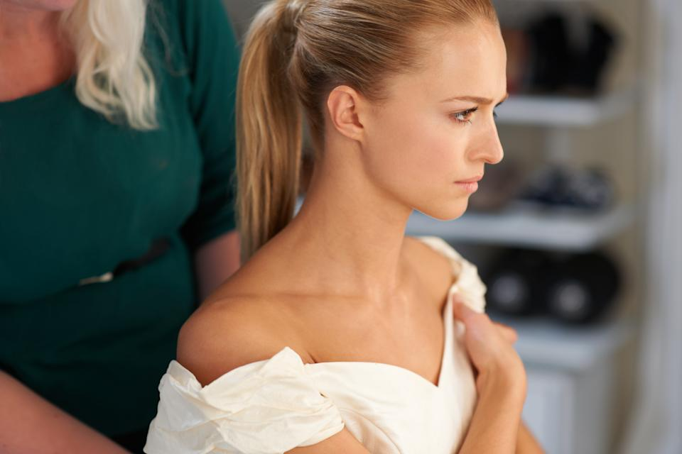 A young bride getting her hair done before the wedding