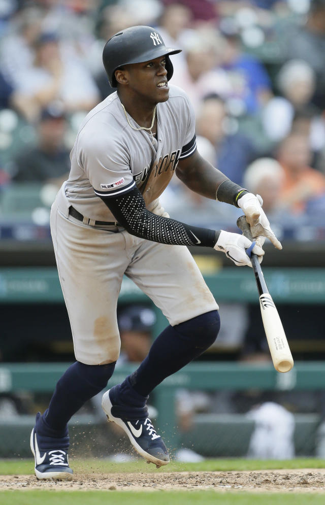 New York Yankees' Cameron Maybin watches his two-run double during the seventh inning of the first game of a baseball doubleheader, Thursday, Sept. 12, 2019, in Detroit. (AP Photo/Duane Burleson)
