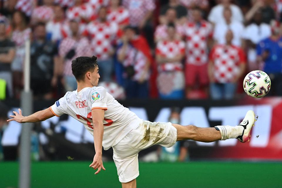 Spain's forward Pedri kikcs the ball during the UEFA EURO 2020 round of 16 football match between Croatia and Spain at the Parken Stadium in Copenhagen on June 28, 2021. (Photo by Jonathan NACKSTRAND / POOL / AFP) (Photo by JONATHAN NACKSTRAND/POOL/AFP via Getty Images)