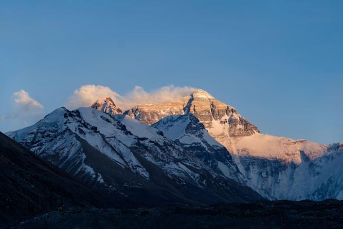 """<div class=""""inline-image__caption""""> <p>Sunlight touches the top of Mt. Everest.</p> </div> <div class=""""inline-image__credit""""> National Geographic/Renan Ozturk </div>"""