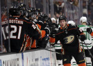 Anaheim Ducks' Ondrej Kase, right, celebrates his goal with teammates during the first period of an NHL hockey game against the Dallas Stars, Wednesday, Dec. 12, 2018, in Anaheim, Calif. (AP Photo/Marcio Jose Sanchez)