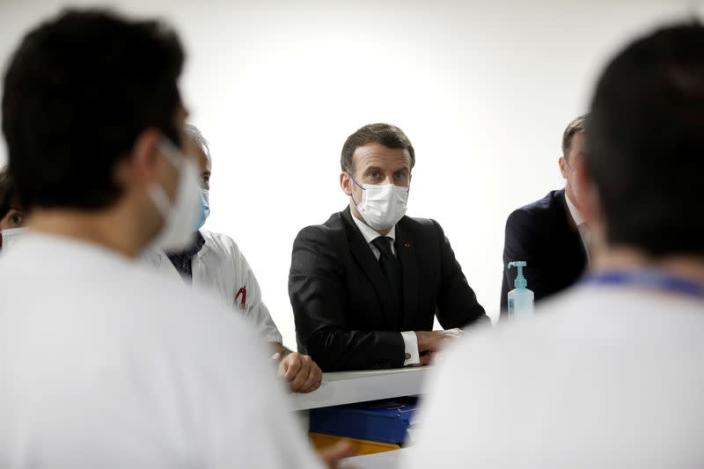 FILE PHOTO: French President Macron visits the ICU unit for COVID-19 patients at Poissy/Saint-Germain-en-Laye hospital