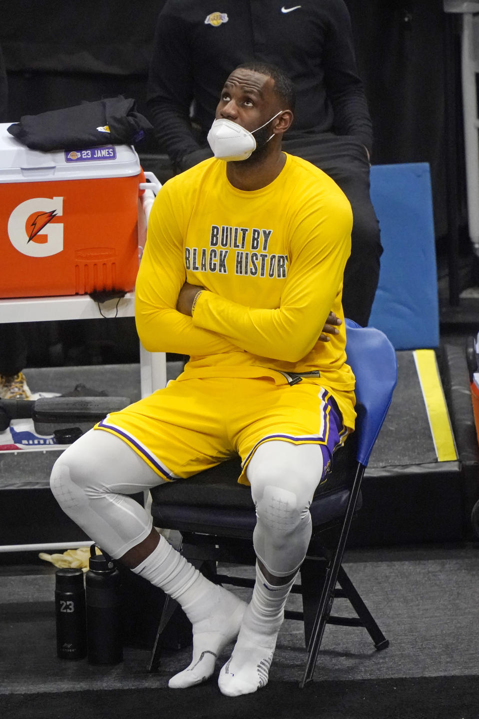 Los Angeles Lakers forward LeBron James looks at the scoreboard while sitting on the bench during the second half of the team's NBA basketball game against the Utah Jazz on Wednesday, Feb. 24, 2021, in Salt Lake City. (AP Photo/Rick Bowmer)