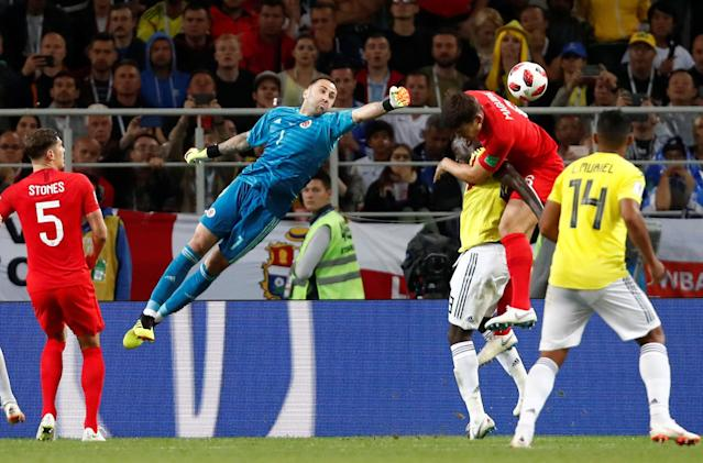 <p>Colombia's David Ospina in action with England's John Stones and Harry Maguire. REUTERS/Maxim Shemetov </p>