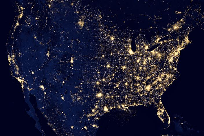 """This image of the United States of America at night is a composite assembled from data acquired by the Suomi NPP satellite in April and October 2012. The image was made possible by the new satellite's """"day-night band"""" of the Visible Infrared Imaging Radiometer Suite (VIIRS), which detects light in a range of wavelengths from green to near-infrared and uses filtering techniques to observe dim signals such as city lights, gas flares, auroras, wildfires, and reflected moonlight. (NASA)"""