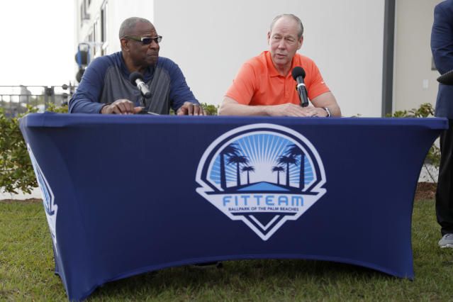 Houston Astros manager Dusty Baker, left, and owner Jim Crane speak during a news conference before the start of the first official spring training baseball practice for the team Thursday, Feb. 13, 2020, in West Palm Beach, Fla. (AP Photo/Jeff Roberson)