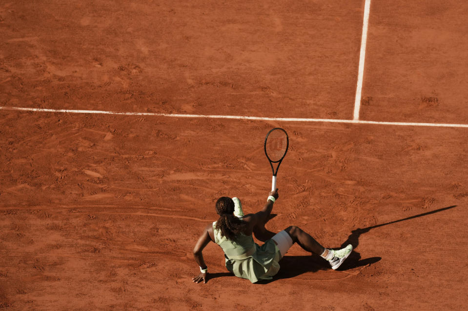 United States Serena Williams slips on the clay court as she attempts to play a return to Kazakhstan's Elena Rybakina during their fourth round match on day 8, of the French Open tennis tournament at Roland Garros in Paris, France, Sunday, June 6, 2021. (AP Photo/Thibault Camus)