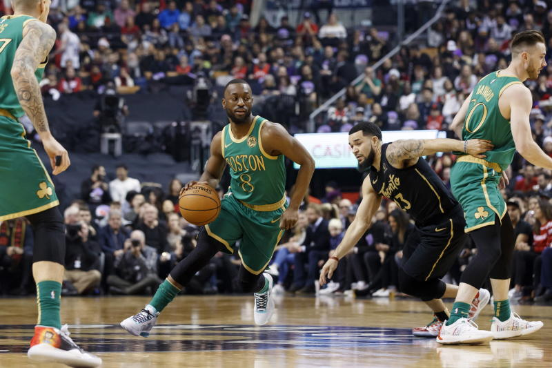 Boston Celtics guard Kemba Walker (8) drives past Toronto Raptors guard Fred VanVleet (23) during first half NBA basketball action in Toronto, Wednesday, Dec. 25, 2019. (Cole Burston/The Canadian Press via AP)