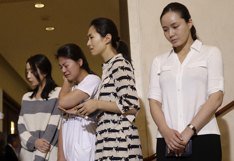 RE-TRANSMIT TO CORRECT POSITION OF YOON-HYE - Asiana Flight 214 cabin manager Lee Yoon-hye, second right, and other flight attendants appear at a news conference at San Francisco International Airport in San Francisco, Wednesday, July 10, 2013. Two passengers were killed and many others were injured when the flight crashed upon landing on Saturday, July 6, 2013. (AP Photo/Jeff Chiu)