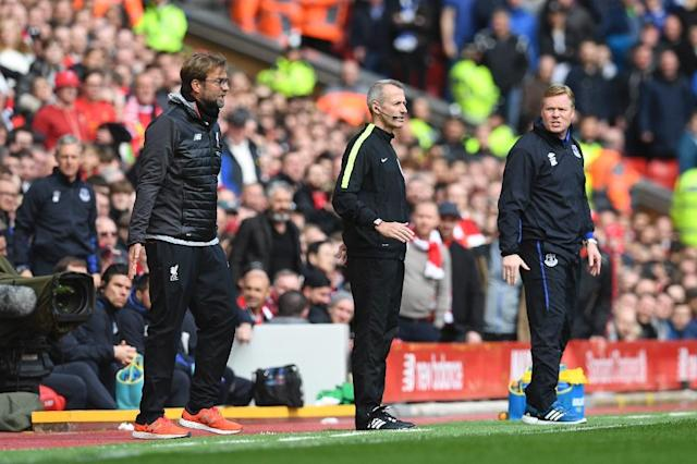 Everton manager Ronald Koeman (far right) looks at his Liverpool counterpart Jurgen Klopp during the Merseyside derby at Anfield in north-west England, on April 1, 2017 (AFP Photo/Paul ELLIS)