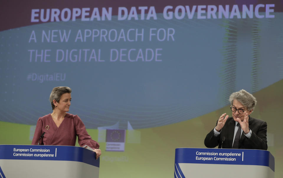 European Commissioner for Europe fit for the Digital Age Margrethe Vestager, left, and European Commissioner for Internal Market Thierry Breton participate in a media conference on European Data Governance at EU headquarters in Brussels, Wednesday, Nov. 25, 2020. (Stephanie Lecocq, Pool via AP)