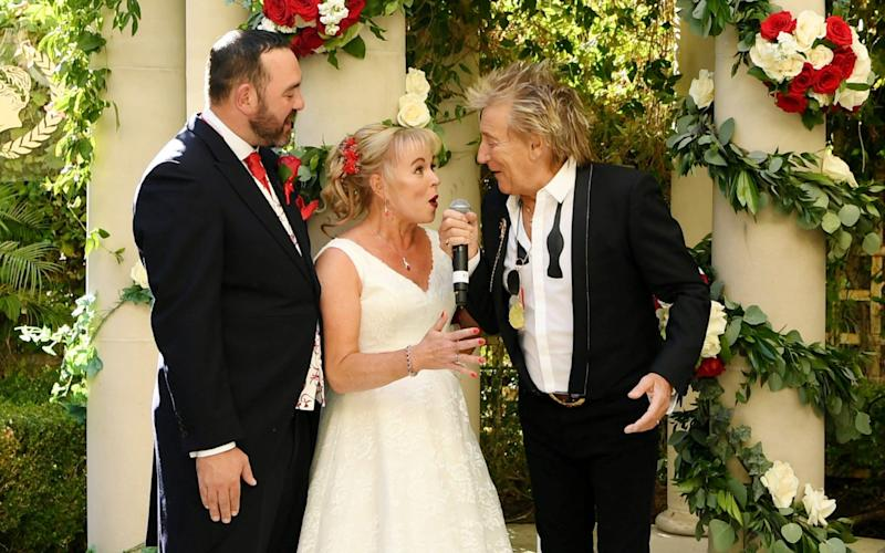 Sir Rod Stewart surprises and serenades wedding couple whose big day was almost ruined by Thomas Cook - WireImage