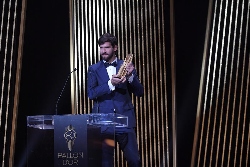PARIS, FRANCE - DECEMBER 02: Alisson Becker (Liverpool) is awarded with the Yashine Trophy during the Ballon D'Or Ceremony at Theatre Du Chatelet on December 02, 2019 in Paris, France. (Photo by Kristy Sparow/Getty Images)