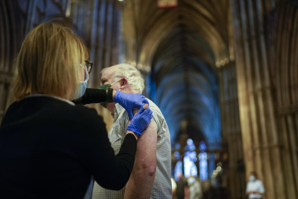 LICHFIELD, ENGLAND - FEBRUARY 26: Members of the public receive their Covid-19 vaccinations at Lichfield Cathedral, Staffordshire on February 26, 2021 in Lichfield, England. Lichfield Cathedral is one of many unusual venues that have been adapted for administering vaccines during the Covid-19, coronavirus pandemic. Over 19 million people in the United Kingdom have had their first Covid-19 vaccination, including 90 percent of over-70s.  (Photo by Christopher Furlong/Getty Images)