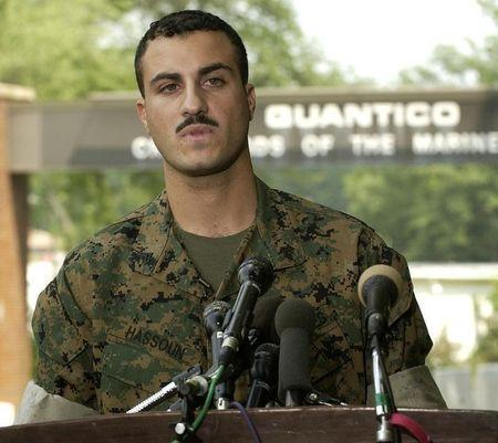 U.S. Marine Corps Corporal Wassef Ali Hassoun reads a prepared statement outside the gate at Quantic..