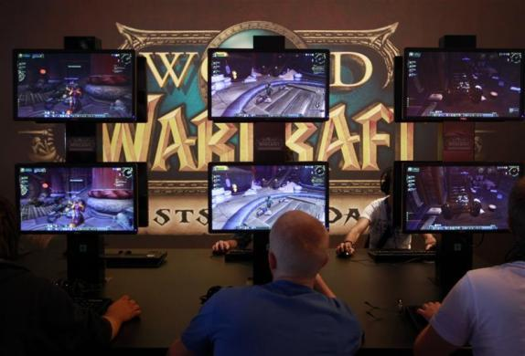 Visitors play ''World of Warcraft'' at an exhibition stand during the Gamescom 2012 fair in Cologne August 15, 2012.