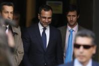 U.S. ambassador in Spain, James Costos (C), leaves the foreign ministry after being summoned to a meeting with Spain's European Secretary of State in Madrid October 28, 2013. REUTERS/Juan Medina