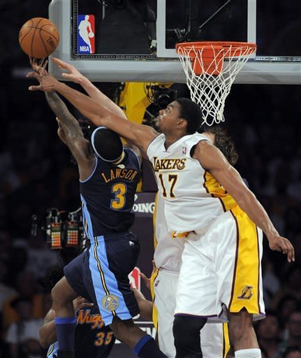Los Angeles Lakers center Andrew Bynum, right, blocks a shot by Denver Nuggets point guard Ty Lawson during the first half of an NBA first-round playoff basketball game, Sunday, April 29, 2012, in Los Angeles. (AP Photo/Mark J. Terrill)