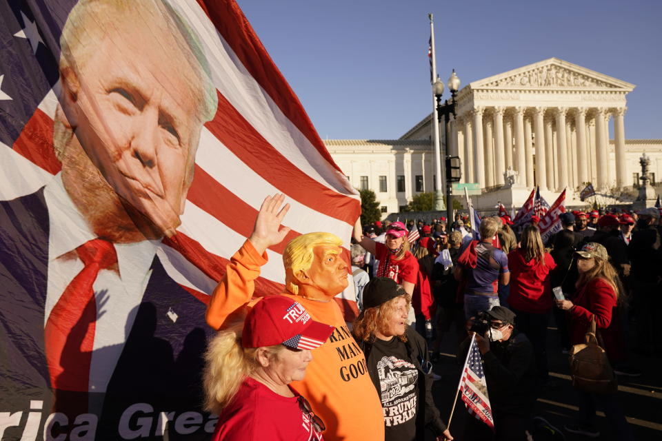 People pose for a photo as supporters of President Donald Trump attend pro-Trump marches outside the Supreme Court building, Saturday Nov. 14, 2020, in Washington. (AP Photo/Jacquelyn Martin)