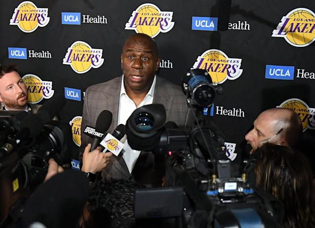 Magic Johnson speaks to the press about resigning as the Lakers' president of basketball operations Tuesday night. (Getty)