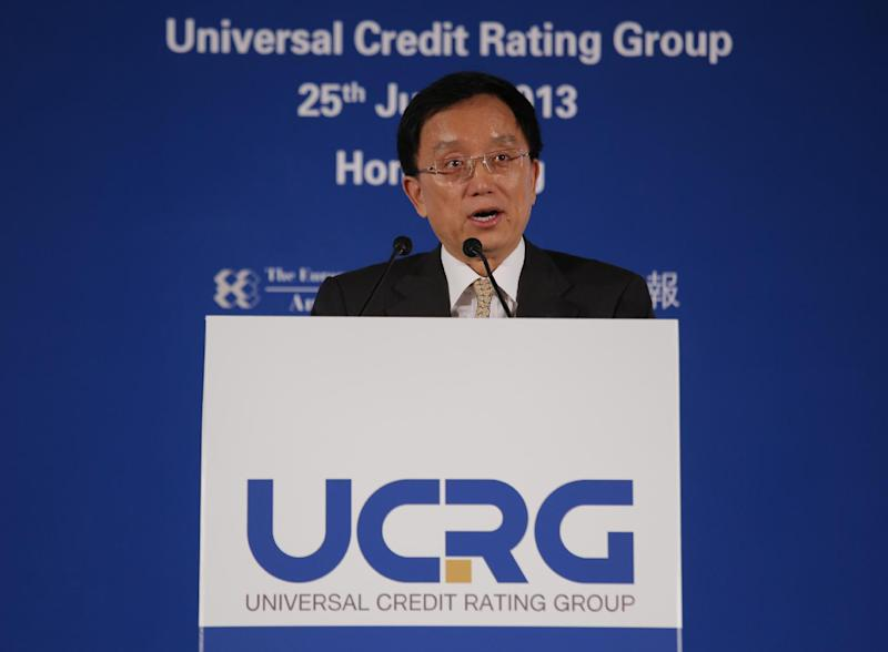 "Guan Jianzhong, chairman of the Universal Credit Rating Group, delivers his speech at the launch ceremony in Hong Kong Tuesday, June 25, 2013. Chinese credit rating company Dagong and its Russian and U.S. partners are launching a new venture to challenge the dominance of the major rating agencies that were blamed for contributing to the global financial crisis.Officials said Tuesday the Universal Credit Rating Group is aimed at ""providing some balance"" to the industry, traditionally cornered by Moody's, Standard & Poor's and Fitch. (AP Photo/Vincent Yu)"