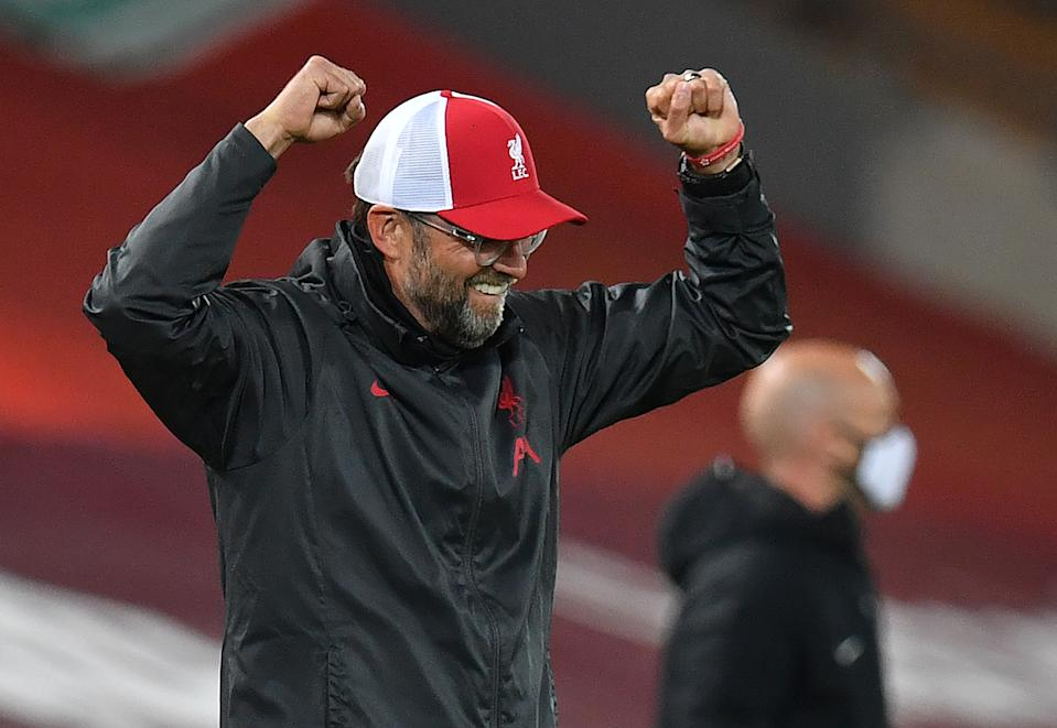 Jurgen Klopp celebrating with his arms raised.