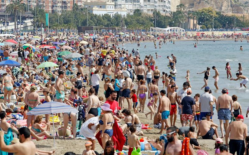People sunbathe and enjoy the sea at Postiguet beach during the Good Friday of the Holy Week in Alicante, eastern Spain, 14 April 2017 - EFE