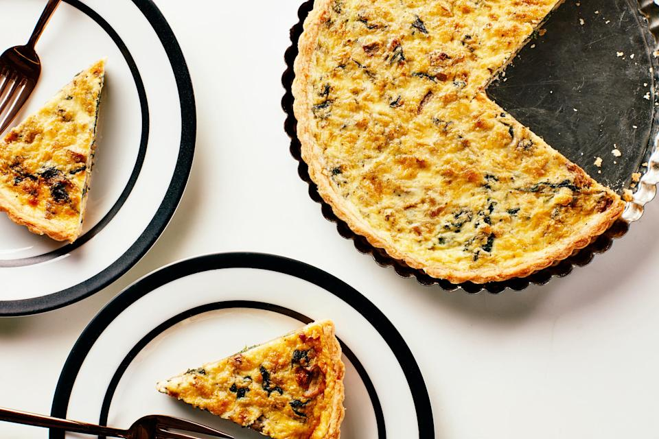 """Both the tart shell and the filling for this luscious quiche can be prepped ahead, making it a great way to round out your picnic menu. <a href=""""https://www.epicurious.com/recipes/food/views/quiche-sardou?mbid=synd_yahoo_rss"""" rel=""""nofollow noopener"""" target=""""_blank"""" data-ylk=""""slk:See recipe."""" class=""""link rapid-noclick-resp"""">See recipe.</a>"""