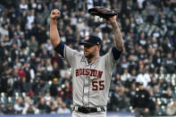 Houston Astros relief pitcher Ryan Pressly (55) celebrates the final out against the Chicago White Sox in the ninth inning during Game 4 of a baseball American League Division Series Tuesday, Oct. 12, 2021, in Chicago. The Astros won 10-1. (AP Photo/Nam Y. Huh)