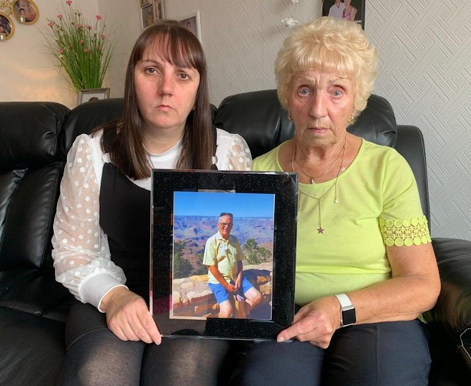 Laura and Mary Alexander with a picture of Ronnie, who froze to death in 2018 (Digby Brown/PA)