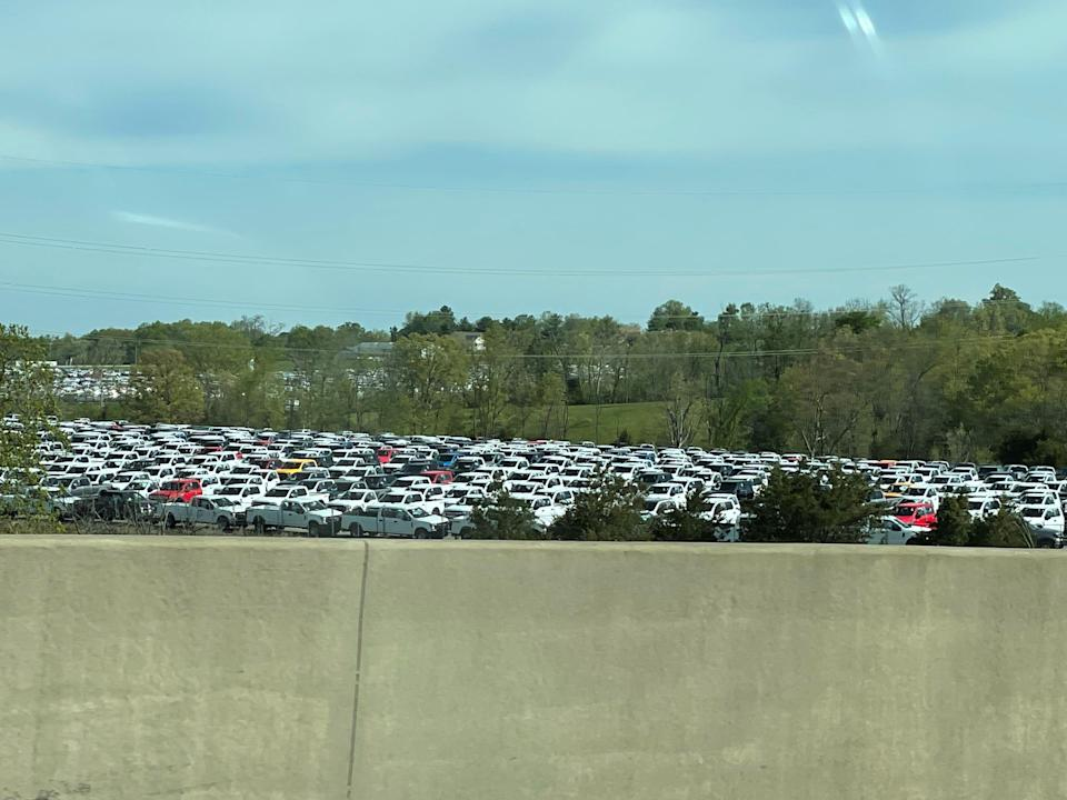 Thousands of pickup trucks could be seen from Interstate 71 in Sparta, Ky., on Sunday. Ford Motor Co. had approximately 22,000 vehicles at the end of March primarily in North America awaiting installation of chip-related components, Chief Financial Officer John Lawler said during a first-quarter earnings call with analysts on April 28, 2021.