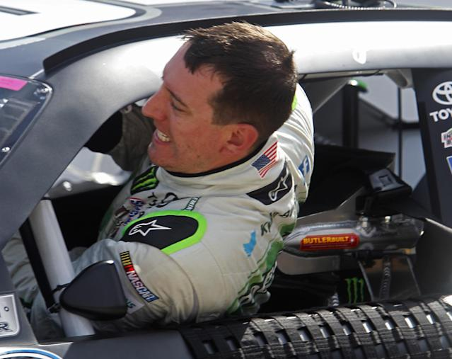 Kyle Busch climbs from his car after qualifying for the Food City 300 NASCAR Nationwide Series auto race at Bristol Motor Speedway on Friday, Aug. 22, 2014, in Bristol, Tenn. Busch will start on the pole. (AP Photo/Wade Payne)