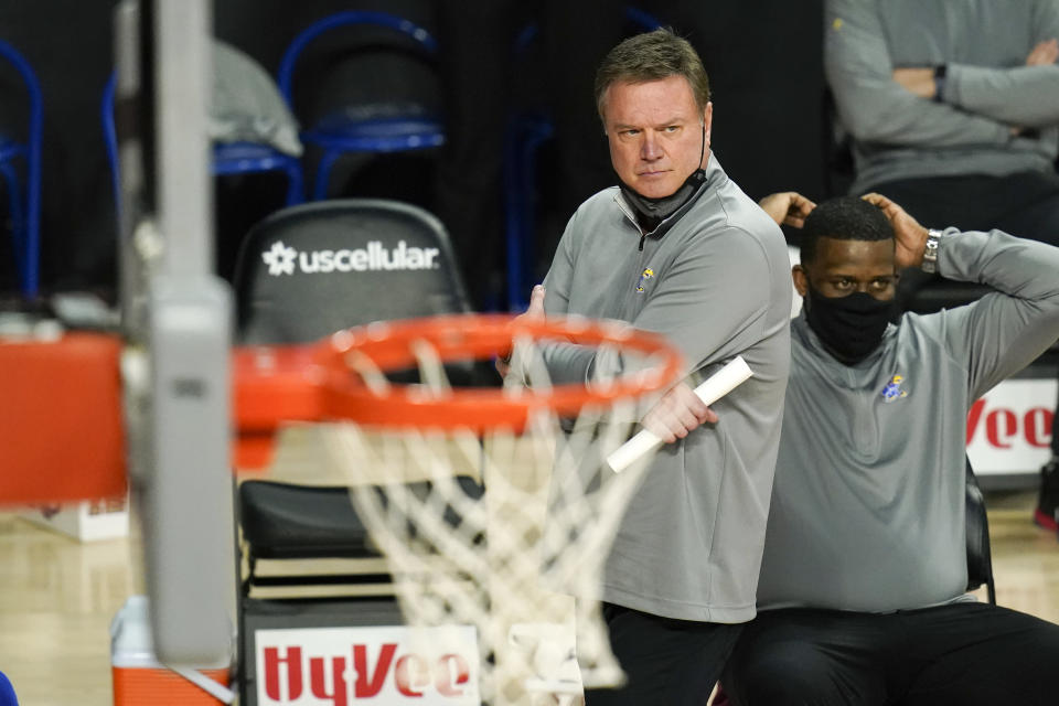 Kansas head coach Bill Self watches from the bench during the second half of an NCAA college basketball game against Iowa State, Saturday, Feb. 13, 2021, in Ames, Iowa. Kansas won 64-50. (AP Photo/Charlie Neibergall)