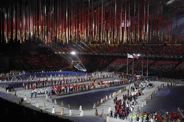 Athletes march into the arena during the closing ceremony of the 2014 Winter Olympics, Sunday, Feb. 23, 2014, in Sochi, Russia. (AP Photo/Matthias Schrader)