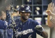Milwaukee Brewers' Lorenzo Cain is congratulated after hitting a home run during the fourth inning of a baseball game against the San Diego Padres Thursday, Sept. 19, 2019, in Milwaukee. (AP Photo/Morry Gash)