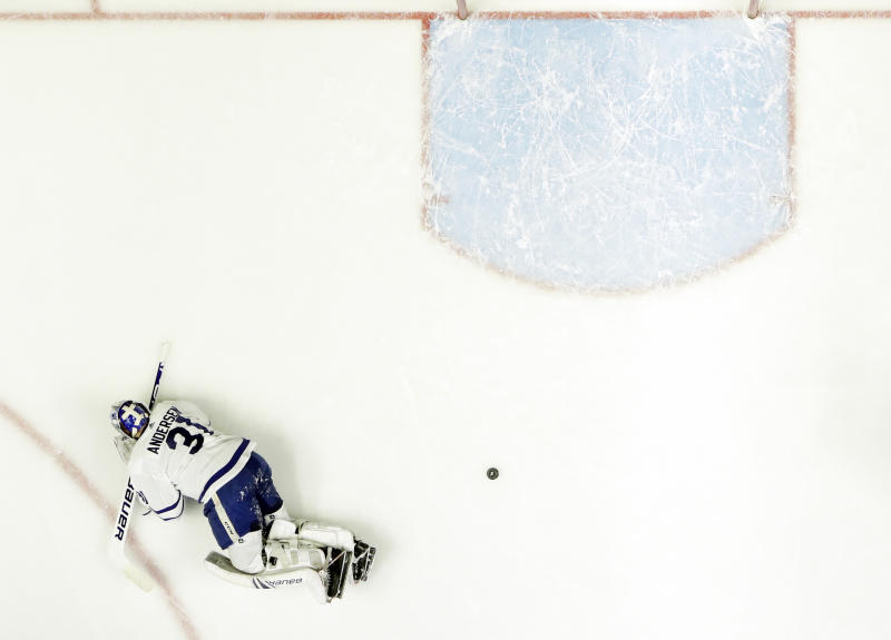Toronto Maple Leafs goaltender Frederik Andersen, of Denmark, gets up off the ice after giving up a goal against the Nashville Predators in the first period of an NHL hockey game Tuesday, March 19, 2019, in Nashville, Tenn. (AP Photo/Mark Humphrey)