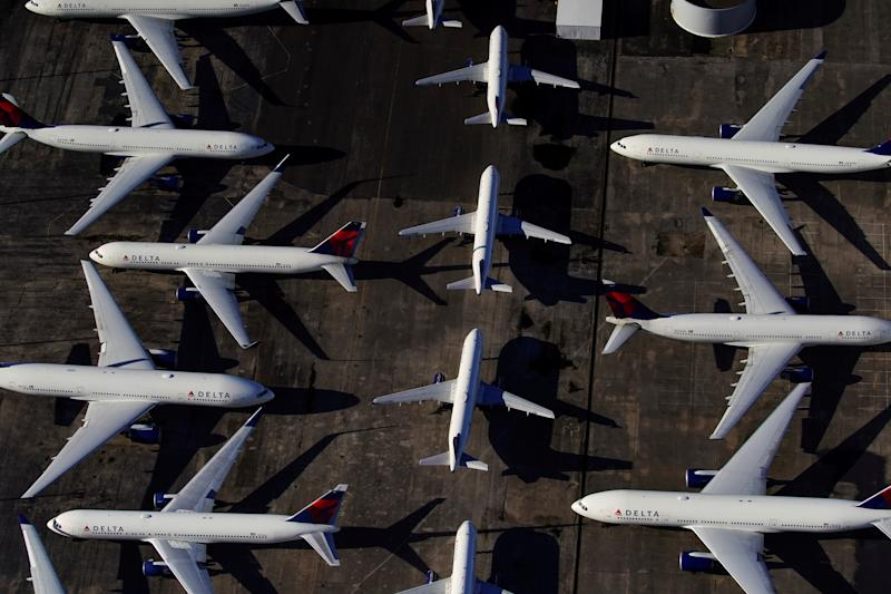 Delta Air Lines passenger planes are seen parked due to flight reductions made to slow the spread of coronavirus disease (COVID-19), at Birmingham-Shuttlesworth International Airport in Birmingham, Alabama, U.S. March 25, 2020. REUTERS/Elijah Nouvelage TPX IMAGES OF THE DAY