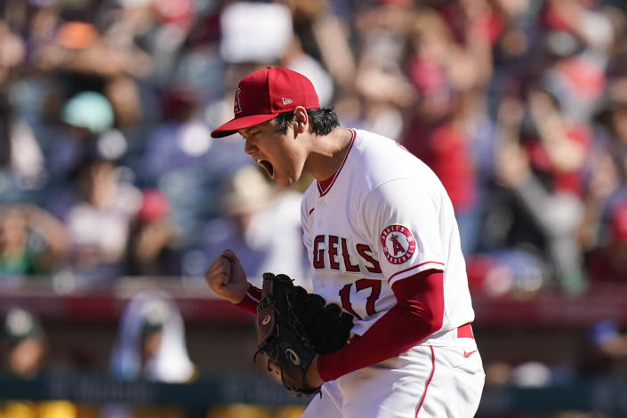 Los Angeles Angels starting pitcher Shohei Ohtani, of Japan, reacts after striking out Oakland Athletics' Matt Chapman to end the eighth inning of a baseball game Sunday, Sept. 19, 2021, in Anaheim, Calif. (AP Photo/Jae C. Hong)