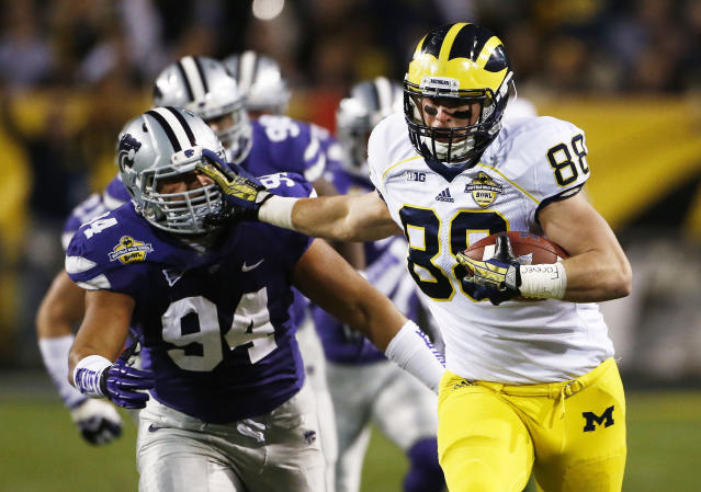 Kansas State's Alauna Finau, left,chases down Michigan tight end Jake Butt during the Buffalo Wild Wings Bowl NCAA college football game on Saturday, Dec. 28, 2013, in Tempe, Ariz. (AP Photo/The Arizona Republic, Rob Schumacher)