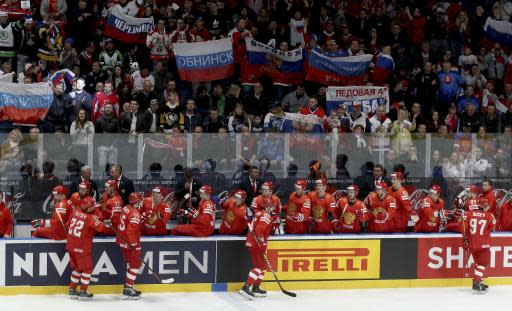 Russia's players and supporters celebrate after scoring during the Ice Hockey World Championships group B match between Russia and Italy at the Ondrej Nepela Arena in Bratislava, Slovakia, Wednesday, May 15, 2019. (AP Photo/Ronald Zak)