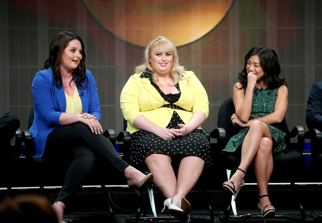 "BEVERLY HILLS, CA - AUGUST 04: Actress Lauren Ash, Writer/actress Rebel Wilson and actress Liza Lapira speak onstage during the ""Super Fun Night"" panel discussion at the Disney/ABC Television Group portion of the Television Critics Association Summer Press Tour at the Beverly Hilton Hotel on August 4, 2013 in Beverly Hills, California. (Photo by Frederick M. Brown/Getty Images)"