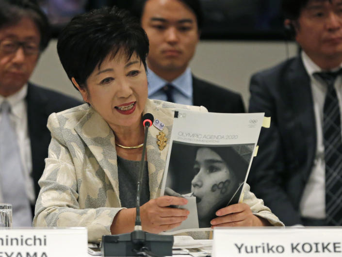 FILE - In this Nov. 29, 2016, file photo, Tokyo Gov. Yuriko Koike speaks at the IOC debriefing meeting in Tokyo. Japan wants to start using the traditional order for Japanese names in English in official documents, with family names first, a switch from the Westernized custom the country adopted more than a century ago. (AP Photo/Shuji Kajiyama, File)