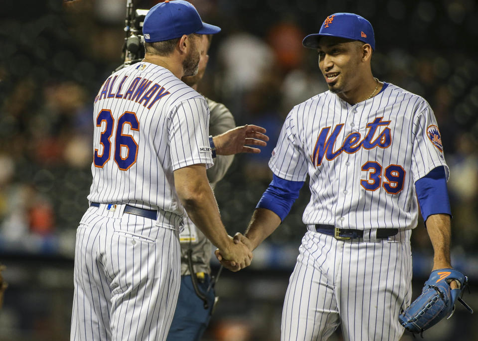 Jun 30, 2019; New York City, NY, USA; New York Mets manager Mickey Callaway (36) and pitcher Edwin Diaz (39) celebrate the 8-5 victory over the Atlanta Braves at Citi Field. Mandatory Credit: Wendell Cruz-USA TODAY Sports